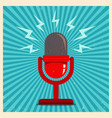 microphone on blue retro background vector image vector image