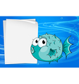 A fish beside a paper under the sea vector image