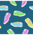 Seamless background with colored trainers vector image