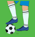 soccer ball under player feet on green background vector image vector image