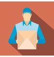 Delivery man holding cardboard box vector image