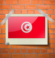 Flags Tunisia scotch taped to a red brick wall vector image