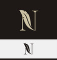 letter n with feather logo on black and white vector image
