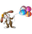easter bunny holding easter eggs balloons vector image