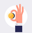 male hand is holding golden coin vector image
