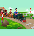 kids and their parents riding a small train vector image