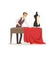 male dressmaker making out clothes on the table vector image vector image