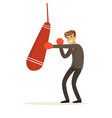 smiling businessman in boxing gloves hitting a vector image vector image