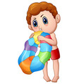 cute little boy blowing an inflatable ring vector image vector image