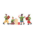 green elves in costumes preparing gifts mix race vector image