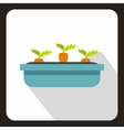 Carrot growing in blue box icon vector image