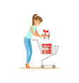 happy woman in a casual clothes putting a gift box vector image vector image