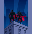 superhero couple roof watch silhouettes vector image vector image