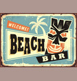 Beach bar advertising with hawaii tiki mask