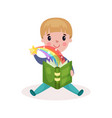 cute little boy reading fairytale book with vector image vector image