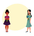 two women girls black and caucasian holding vector image vector image