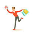 happy young man in a red pullover running with vector image vector image