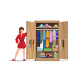 woman with open closet vector image vector image