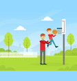 father and son playing basketball outdoors happy vector image