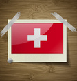 Flags Switzerland at frame on wooden texture vector image