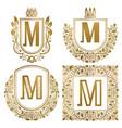 golden vintage monograms set heraldic logos m vector image vector image