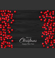 christmas holly berry on black wooden vector image vector image
