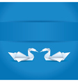 Origami swans on blue background vector image vector image