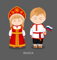 Russians in national dress with a flag