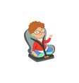 cute little boy in glasses sitting in car seat vector image vector image