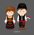 serbs in national dress with a flag vector image vector image