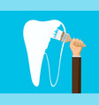 man paints a human tooth with white paint vector image vector image