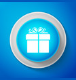 white gift box icon isolated on blue background vector image vector image