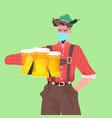 man in medical mask holding beer mugs oktoberfest vector image vector image