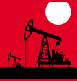 oil pump on a background red sky vector image