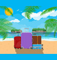 modern and vintage travel bag on beach vector image