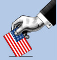 hand putting voting paper with the usa flag vector image vector image
