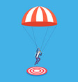 businessman with parachute aiming on target risky vector image vector image