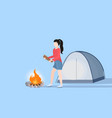 woman hiker making fire girl holding firewood for vector image vector image