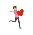 happy teen boy walking with red heart happy vector image vector image