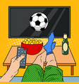 man with remote control watching football on tv vector image vector image