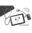 Tablet touch pad and office supplies on the table vector image