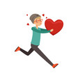 happy teen boy running with red heart happy vector image