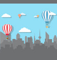 hot air balloons over the city vector image
