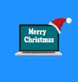 laptop is in the Santa hat vector image vector image