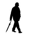 silhouettes of man walking with an umbrella vector image vector image