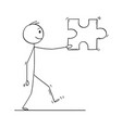 cartoon of man or businessman carrying big jigsaw vector image