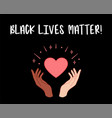 black lives matter hands holding red heart vector image vector image
