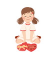 cute girl with chocolate candies in heart shaped vector image