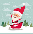 santa claus with carriage in snowscape vector image vector image