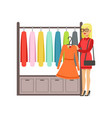 woman choosing dress during shopping beautiful vector image